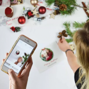Photos of personalised christmas cards on a phone