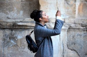 Take your selfies for sending postcards while travelling